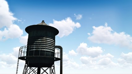 Silhouette of the old rusty water tower against blue cloudy sky