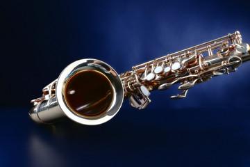 Golden saxophone on dark background