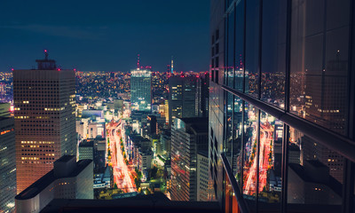 Aerial view cityscape at night in Tokyo, Japan from a skyscraper Fotomurales