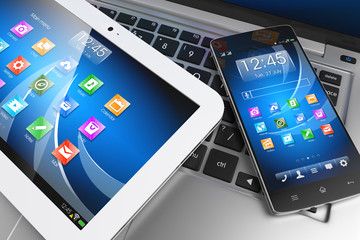 Mobile devices. Tablet PC, smartphone on laptop, technology conc