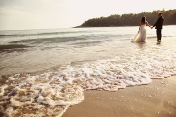 Bride and groom at the beach