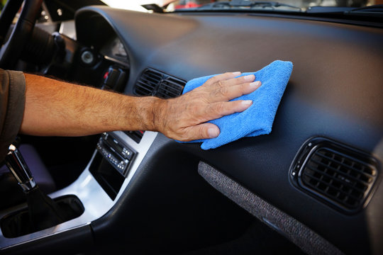 Hand cleaning car interior