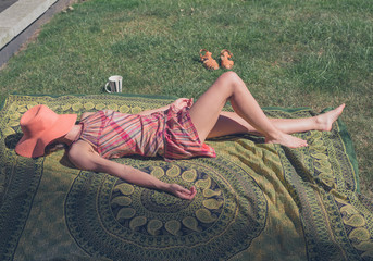 Young woman lying on the grass outside