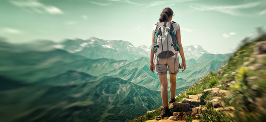Fotomurales - Rear View of Woman Hiking in Mountain Range