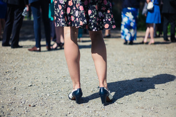 Legs of young woman at party