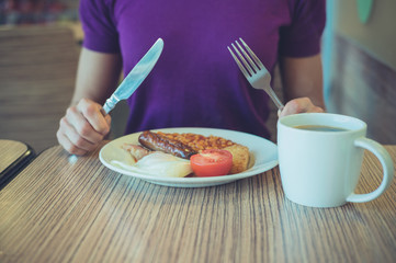 Woman enjoying traditional english breakfast