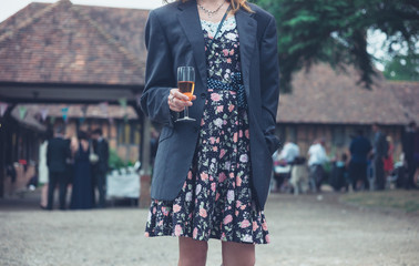 Young woman wearing jacket and drinking wine