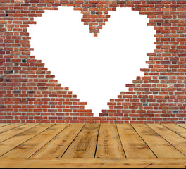 Symbol of love, brick wall heart with wooden table inside