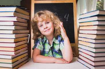 Portrait of cute schoolgirl raising hand knowing the answer to t