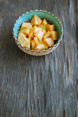 fresh fruits background with honeydew melon on rustic wooden table