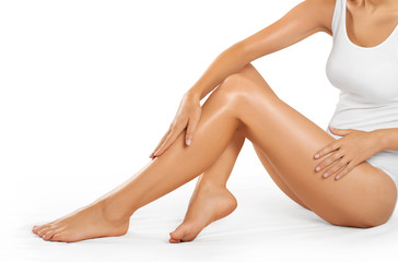 Beautiful woman legs on a white background.