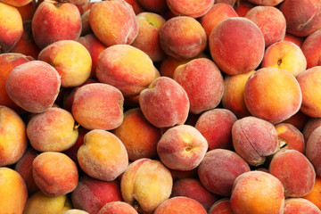 Ripe peach fruit background, close up