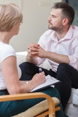 Male during session with psychiatrist