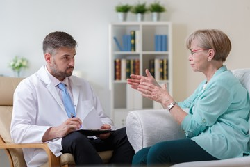 Psychiatrist listening his female patient