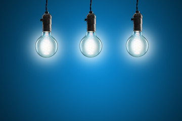 Idea concept - Vintage incandescent bulbs on blue background