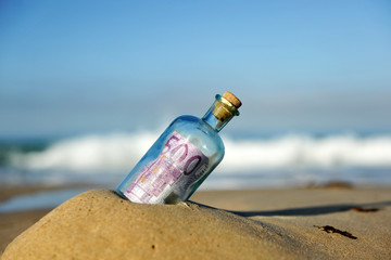 500 euro note in a bottle found on the beach, southern Europe