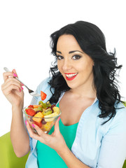 Young Woman Eating a Fresh Fruit Salad