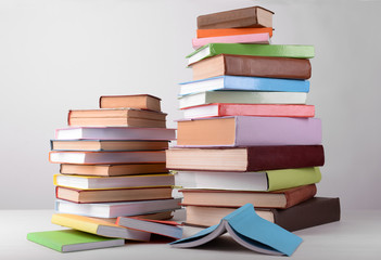 Heap of books on grey background