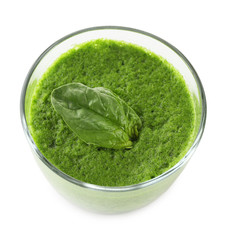 Glass of green vegetable juice with basil isolated on white