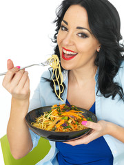 Young Woman Eating Noodles with Stir Fried Vegetables