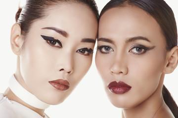 Asian faces on white