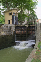 The canal du midi connects the Garonne River to the Étang de Thau on the Mediterranean sea..The Tide Gate is located near Castelnaudary in Southern France