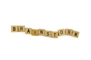 Brainstorm word wooden alphabet blocks on white background from