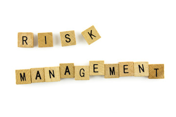 """RISK MANAGEMENT"" text on wooden cubes, isolated on white backgr"