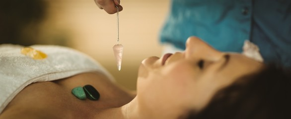 Young woman at crystal healing session energy healing