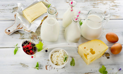 Fresh Dairy products on a white wooden background.