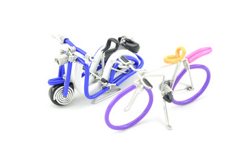 image focus to classic blue and black wired scooter with purple bicycle in front isolated white background