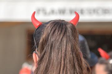 Red devil horns girl from the back