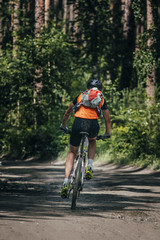 Mountainbiker rides race in forest