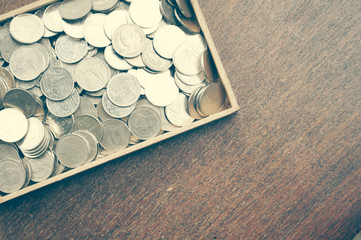 coins on wood with filter effect retro vintage style