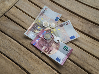 Cash Euro and key for small business deal
