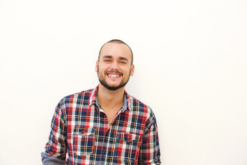 Happy hispanic guy in plaid shirt