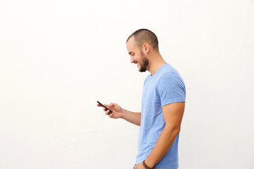 Handsome man with beard walking with mobile phone