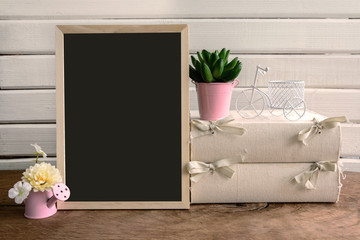 Shelf decoration with blackboard and flower on white background