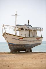 Small wooden fishing boat standing on the beach, Margarita Islan