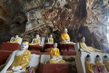 Kaw Goon Cave / Many of Buddha Images and Hundreds of rock carvings of Buddha Image on limestone at Kaw-goon ancient cave in Kaw-goon Village, Hpa-an, Kayin State, Myanmar.