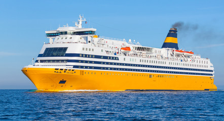 Yellow passenger ferry goes on the Sea