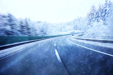 Dangerous blurred highway winter driving. Winter snowy conditions on the highway. Motion blur visualizies the speed and dynamics.