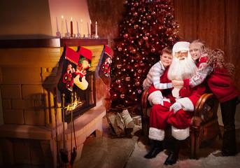 Winking Classic Santa sitting with Happy Children