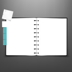 Open spiral notebook with white page and tabs.