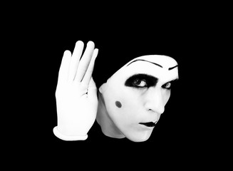 Portrait of  overhearing mime in white gloves