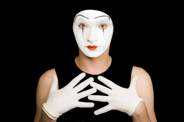 Portrait of  mime in white gloves