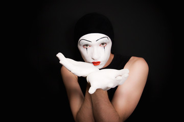 Gesticulating mime in white gloves