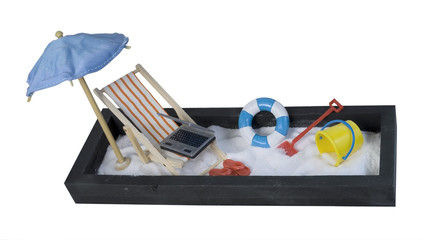 Beach Chair with Laptop and Umbrella and Sand
