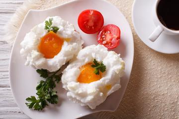 beautiful breakfast: eggs Orsini and coffee horizontal top view