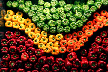 red green yellow orand and red peppers on display